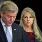 Maureen McDonnell looks on as her husband, former Virginia Gov. Bob McDonnell, made a statement on Tuesday after the couple was indicted on corruption charges. (associated press)