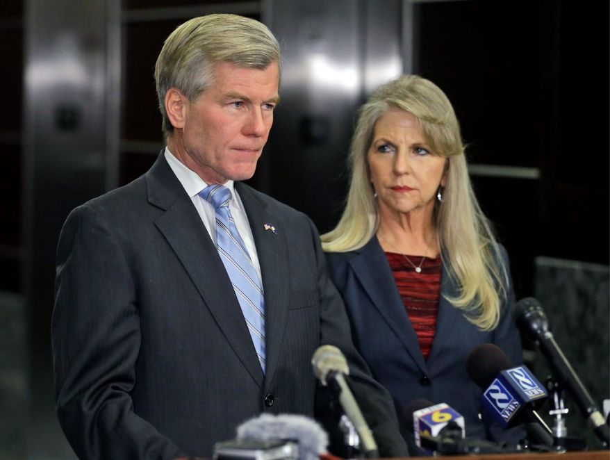 Former Virginia Gov. Bob McDonnell makes a statement as his wife, Maureen, listens during a news conference in Richmond, Va., Tuesday, Jan. 21, 2014.  McDonnell and his wife were indicted Tuesday on corruption charges after a monthslong federal investigation into gifts the Republican received from a political donor.  (AP Photo/Steve Helber)