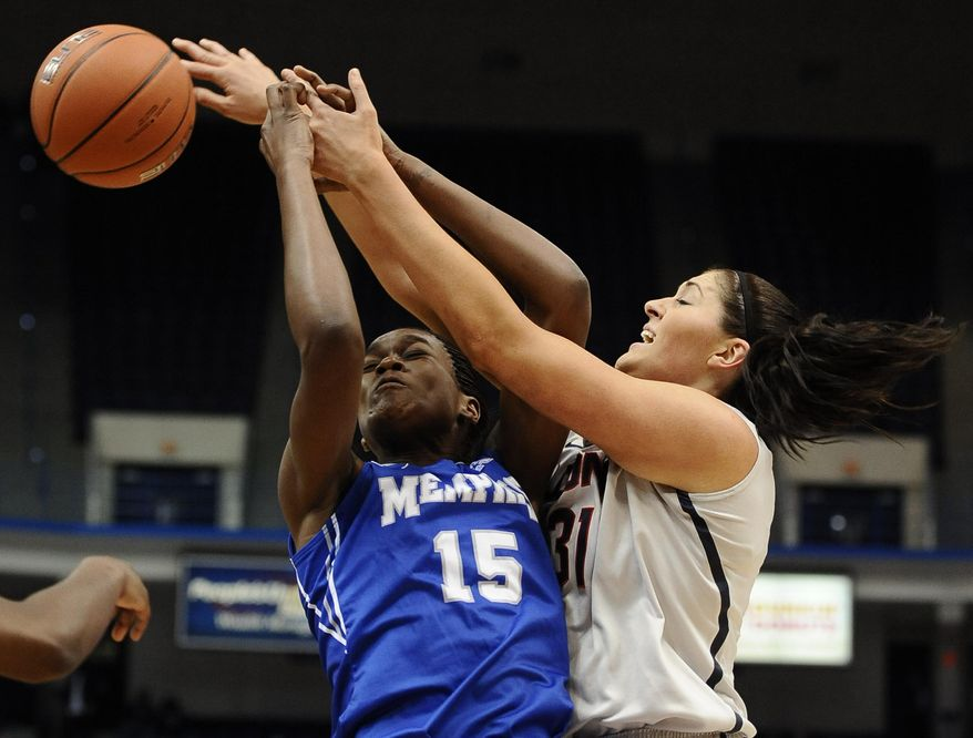 Memphis' Pa'Sonna Hope, left, and Connecticut's Stefanie Dolson, right, vie for a rebound during the first half of an NCAA college basketball game, Wednesday, Jan. 22, 2014, in Hartford, Conn. (AP Photo/Jessica Hill)