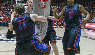 New Mexico's Hugh Greenwood (3) powers his way to the hoop against Boise State's Jeff Elorriaga (11) during the first half of an NCAA college basketball game at The Pit in Albuquerque, N.M., Tuesday, Jan. 21, 2014. (AP Photo/Juan Antonio Labreche)