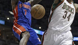 Detroit Pistons' Brandon Jennings (7) dunks against Milwaukee Bucks' Giannis Antetokounmpso (34) during the first half of an NBA basketball game Wednesday, Jan. 22, 2014, in Milwaukee. (AP Photo/Jeffrey Phelps)