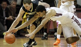 Virginia Tech's Joey van Zegeren, right, dives for a loose ball next to Wake Forest's Tyler Cavanaugh during the second half of an NCAA college basketball game in Blacksburg, Va., Wednesday, Jan. 22 2014. Wake Forest won 83-77. (AP Photo/The Roanoke Times, Matt Gentry)