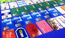 Credit cards that were confiscated are displayed at the McAllen Police Department in McAllen, Texas, after McAllen police arrested a man and a woman on fraud charges, Monday, Jan. 20, 2014. According to a South Texas police chief, the suspects used account information stolen during the Target security breach to buy tens of thousands of dollars' worth of merchandise, but a spokesman for the U.S. Secret Service said Tuesday that an investigation is ongoing into the possibility of a link between the Target data breach and the arrests. (AP Photo/The Monitor, Gabe Hernandez)