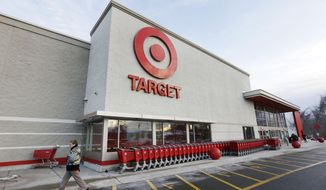 FILE - In this Dec. 19, 2013, file photo, a passer-by walks near an entrance to a Target retail store in Watertown, Mass. Target, based in Minneapolis, said Wednesday, Jan. 22, 2014, the majority of its part-time workers who have been eligible for its health care insurance coverage don't enroll. In fact, less than 10 percent of its total employees of 361,000 take advantage of the part-time plan. It said it will stop covering the part-time workers beginning April 1. AP Photo/Steven Senne, File)