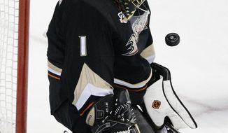 Anaheim Ducks goalie Jonas Hiller, of Switzerland, makes a save during the first period of an NHL hockey game against the Winnipeg Jets, Tuesday, Jan. 21, 2014, in Anaheim, Calif. (AP Photo/Jae C. Hong)