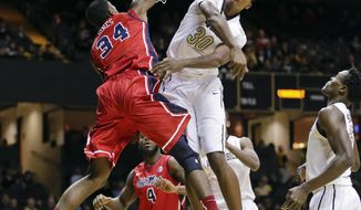 Vanderbilt center Damian Jones (30) blocks a shot by Mississippi forward Aaron Jones (34) in the first half of an NCAA college basketball game Wednesday, Jan. 22, 2014, in Nashville, Tenn. (AP Photo/Mark Humphrey)