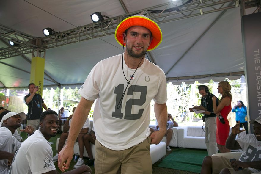 Indianapolis Colts quarterback Andrew Luck walks out to the stage after being chose in the NFL football Pro Bowl draft, Wednesday, Jan. 22, 2014, in Kapolei, Hawaii. (AP Photo/Marco Garcia)