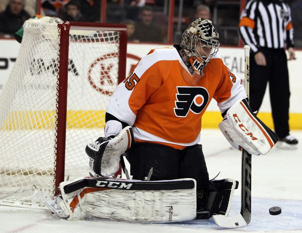 Philadelphia Flyers' Steve Mason deflects a shot on goal during the first period of an NHL hockey game against the Carolina Hurricanes,  Wednesday, Jan. 22, 2014, in Philadelphia.