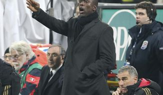 AC Milan coach Clarence Seedorf, of the Netherlands, gestures during the Italian Cup soccer match between AC Milan and Udinese at the San Siro stadium in Milan, Italy, Wednesday, Jan. 22, 2014. (AP Photo/Antonio Calanni)
