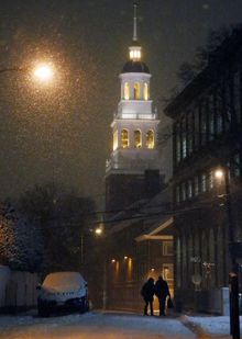 A couple walk as snow falls in Harvard Square in Cambridge, Mass. Tuesday, Jan. 21, 2014. Heavy snow has been forecast and a blizzard warning was posted for portions of Massachusetts. (AP Photo/Elise Amendola)
