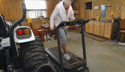 ADVANCE FOR USE SUNDAY, JAN. 26 AND THEREAFTER - In this Dec. 31, 2013 photo, Alonna Dukeman, who suffered a stroke in May 2012, works out on a treadmill at her home in rural Clinton, Ill. About a year ago, she and her fiance Ron Deatrick began attending meetings of the Stroke/Brain Injury Support Group of the Bloomington-Normal Area. She learned she was not alone. (AP Photo/The Pantagraph, David Proeber)