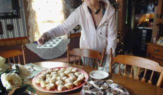 ADVANCE FOR USE SUNDAY, JAN. 26 AND THEREAFTER - In this Dec. 31, 2013 photo, Alonna Dukeman uses a miniature cupcake tin to aid her in making candy for the holidays at her home in rural Clinton, Ill. Dukeman is recovering from a stroke she suffered in 2012. (AP Photo/The Pantagraph, David Proeber)