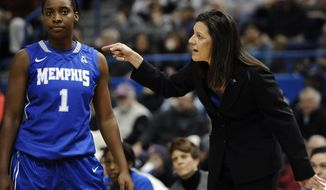 Memphis coach Melissa McFerrin, right, speaks to Breigha Wilder-Cochran during the first half of an NCAA college basketball game against Connecticut, Wednesday, Jan. 22, 2014, in Hartford, Conn. (AP Photo/Jessica Hill)