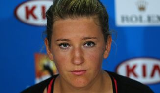 Victoria Azarenka of Belarus speaks during a press conference after her quarterfinal loss to Agnieszka Radwanska of Poland at the Australian Open tennis championship in Melbourne, Australia, Wednesday, Jan. 22, 2014. (AP Photo/Shuji Kajiyama)