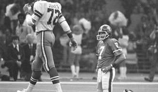 FILE - In this Jan. 15, 1978 file photo,  Denver Broncos quarterback Craig Morton (7) rests briefly on his knees after being sacked by Dallas Cowboys defensive end Ed Jones (72) following the play during NFL football's Super Bowl XII in New Orleans. The Cowboys defeated the Broncos 27-10. Peyton Manning will become only the third quarterback to start for two franchises in the Super Bowl. The first guy to do it, Morton, is among the thousands of former players suing the NFL about concussions. (AP Photo/File)