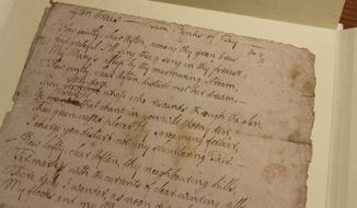 """This photo provided by the University of South Carolina on Jan. 21, 2014, shows a portion of the rare, handwritten manuscript of the poem """"Afton Braes"""" penned by Scottish national poet Robert Burns in 1789. The manuscript become part of the Scottish literature collection at the University of South Carolina. (AP Photo/University of South Carolina, Megan Sexton)"""