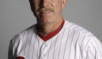 "FILE - In this March 2012 file photo, Mike Schmidt of the Philadelphia Phillies baseball team poses for a photo in Clearwater, Fla. Schmidt is dealing with an undisclosed health issue and will not be a guest instructor for the Phillies at spring training this year. Schmidt still plans to visit camp in the middle of March, the team says in a statement. However, the former third baseman won't serve as an instructor for the first time in more than decade so he can ""remain near his doctors."" (AP Photo/Matt Slocum, File)"