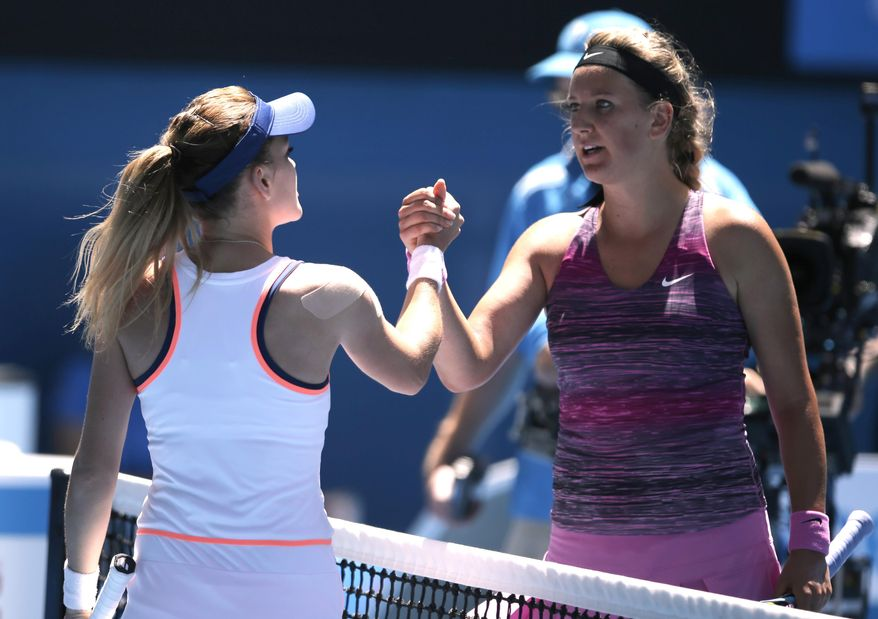 Agnieszka Radwanska of Poland, left, shakes hands with Victoria Azarenka of Belarus at the net after Radwanska won their quarterfinal at the Australian Open tennis championship in Melbourne, Australia, Wednesday, Jan. 22, 2014.(AP Photo/Rick Rycroft)