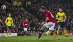 Manchester United's Jonny Evans, centre right, scores against Sunderland during their English League Cup semifinal second leg soccer match at Old Trafford Stadium, Manchester, England, Wednesday Jan. 22, 2014. (AP Photo/Jon Super)