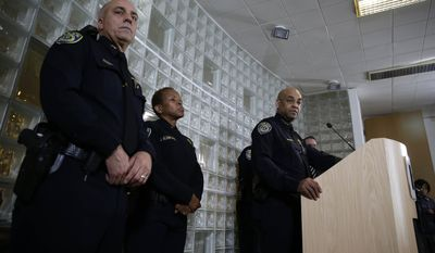 Bay Area Rapid Transit police chief Kenton Rainey, at podium, answers questions about the shooting of a BART officer who was killed by a fellow officer during a news conference Wednesday, Jan. 22, 2014, in Oakland, Calif. Authorities say a San Francisco Bay Area public transit officer who was shot and killed Tuesday by a fellow officer while searching an apartment was looking for a laptop and other stolen items. Rainey declined to disclose any further details of how the shooting of Sgt. Tom Smith occurred. A robbery suspect was in custody. (AP Photo/Eric Risberg)