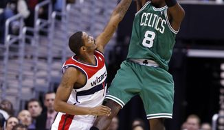 Boston Celtics forward Jeff Green (8) shoots over Washington Wizards forward Trevor Ariza (1) in the second half of an NBA basketball game, Wednesday, Jan. 22, 2014, in Washington. Green had 39 points, and the Celtics won 113-111, in overtime. (AP Photo/Alex Brandon)