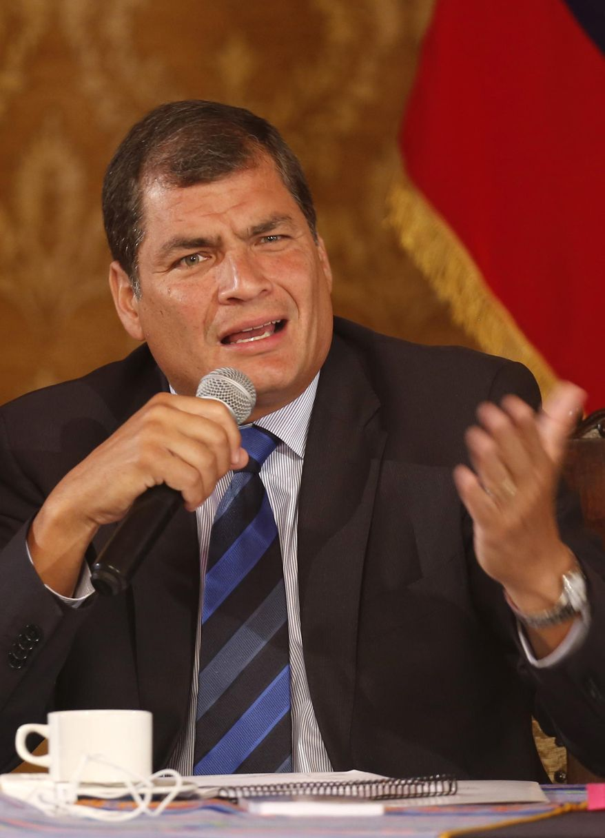 Ecuador's President Rafael Correa speaks to members of the foreign press at the government palace in Quito, Ecuador, Wednesday, Jan. 22, 2014. Correa, who was first elected in January 2007, said the relationship between his government and the U.S. government are tense and there is mutual distrust, clarifying that he is not anti-American and personally likes the U.S. where he earned two university degrees. (AP Photo/Dolores Ochoa)