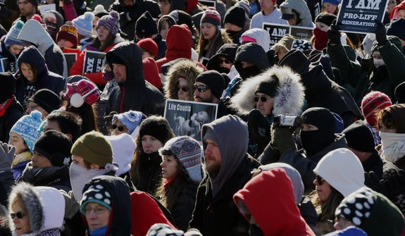 Anti-abortion demonstrators participate in the annual March for Life, Wednesday, Jan. 22, 2014, on the National Mall in Washington. Thousands of anti-abortion demonstrators are gathering in Washington for an annual march to protest the Supreme Court's landmark 1973 decision that declared a constitutional right to abortion. (AP Photo/Charles Dharapak)
