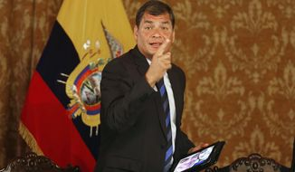 Ecuador's President Rafael Correa gestures at the end of a meeting with the foreign press at the government palace in Quito, Ecuador, Wednesday, Jan. 22, 2014. Correa, who was elected in January 2007, said the U.S. government and his are going through a tense relationship, clarifying that he personally likes the U.S. where he earned two university degrees.  (AP Photo/Dolores Ochoa)