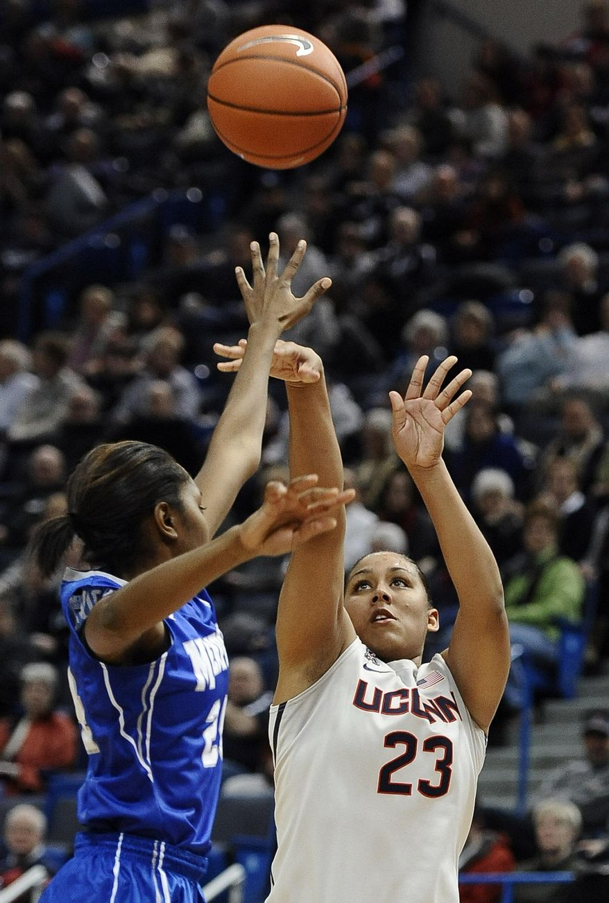 Connecticut's Kaleena Mosqueda-Lewis shoots over Memphis' Mooriah Rowser, left, during the first half of an NCAA college basketball game Wednesday, Jan. 22, 2014, in Hartford, Conn. (AP Photo/Jessica Hill)