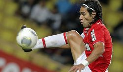 FILE - This is a Friday, Nov. 8, 2013 file photo of Monaco's  Radamel Falcao of Colombia controls the ball during his French League One soccer match against Evian, in Monaco stadium.  Monaco's Colombia striker l Falcao faces an anxious wait to find out if he has a serious knee injury after being taken off on a stretcher in the French Cup on Wednesday Jan. 22, 2014. (AP Photo/Lionel Cironneau, File)