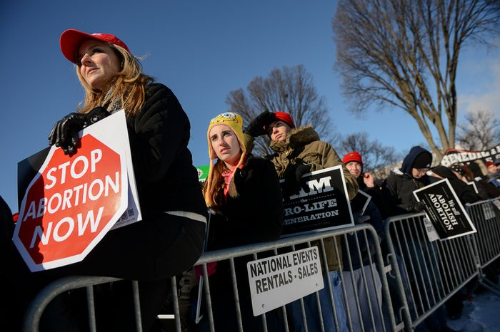 State Rep. Lenar Whitney of Louisiana, left, joins thousands of anti-abortion demonstrators at a rally at the annual March for Life on the National Mall, Washington, D.C., Wednesday, January 22, 2014. (Andrew Harnik/The Washi