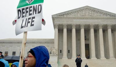 ** FILE ** Gina Hall of Largo, Md., was among the thousands of people to march to the U.S. Supreme Court in Washington, D.C., on Monday, Jan. 23, 2012 in hopes of overturning Roe v. Wade as part of the March for Life. (Barbara L. Salisbury/The Washington Times)