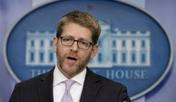 White House press secretary Jay Carney speaks during his daily news briefing at the White House in Washington, Wednesday, Jan. 22, 2014. Carney discussed the Syrian peace talks, security at the Sochi 2014 Olympics and other topics. (AP Photo/Carolyn Kaster)