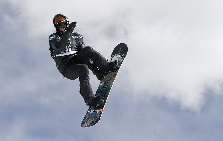 FILE - In hits Dec. 19, 2013, file photo, Shaun White flies off a jump during the World Cup U.S. Grand Prix snowboarding qualifications in Frisco, Colo. On a video posted to a sponsor's YouTube site Thursday, Dec. 26, 2013, White shows the world the trick he's been working on for the upcoming Olympics. It's a frontside double-cork 1440, which resembles his Double McTwist 1260 but adds another half revolution of twist inside the two head-over-heels flips. (AP Photo/Julie Jacobson, File)