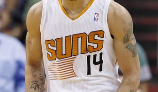 Phoenix Suns' Gerald Green shouts in celebration after scoring against the Indiana Pacers during the first half of an NBA basketball game, Wednesday, Jan. 22, 2014, in Phoenix. (AP Photo/Ross D. Franklin)