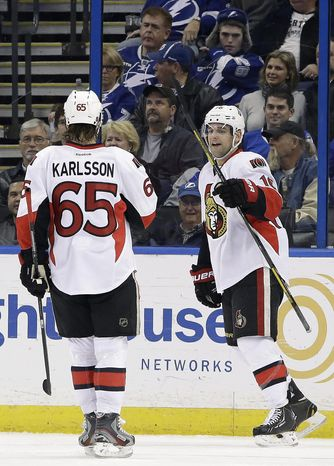 Ottawa Senators left wing Clarke MacArthur (16) celebrates his goal against the Tampa Bay Lightning with teammate Erik Karlsson (65) during the second period of an NHL hockey game Thursday, Jan. 23, 2014, in Tampa, Fla. (AP Photo/Chris O'Meara)