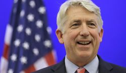 ** FILE ** Virginia Attorney General-elect Mark Herring smiles during a news conference at the Capitol in Richmond, Va., in this Dec. 18, 2013, file photo. Herring has concluded that the state's ban on gay marriage is unconstitutional and he will no longer defend it in federal lawsuits challenging it, his office said Thursday, Jan. 23, 2014. (AP Photo/Steve Helber, File)