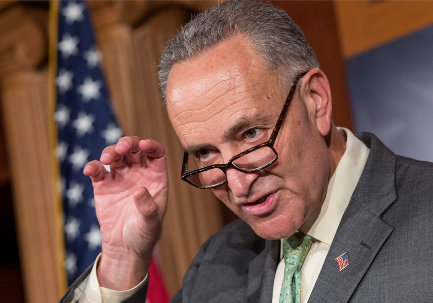 """Do what a handful of states have done and have a primary where all voters, members of every party, can vote and the top two vote-getters, regardless of party, then enter a runoff,"" Sen. Charles E. Schumer suggests in his scheme to weaken the tea party. (Associated Press)"