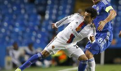 FILE - This is a  Wednesday, Sept.  18, 2013 file photo of Basel's Mohamed Salah, left, as he holds the ball away from Chelsea's Frank Lampard  during the Champions League group E soccer match between Chelsea and Basel at Stamford Bridge stadium in London, Wednesday, Sept.  18, 2013.  Chelsea said Thursday Jan 23, 2014 that it has struck a deal with Swiss club FC Basel to sign midfielder Mohamed Salah. The Premier League club says the Egypt international's move is subject to him agreeing to personal terms and completing a medical. (AP Photo/Kirsty Wigglesworth, File)