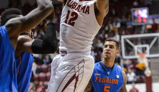 Alabama guard Trevor Releford (12) gets loose under the basket during an NCAA college basketball game against Florida on Thursday, Jan. 23, 2014, at Coleman Coliseum in Tuscaloosa, Ala. (AP Photo/AL.com, Vasha Hunt) MAGS OUT