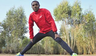In this photo taken Monday, Jan. 20, 2014, Ethiopian distance running great and 5,000 and 10,000 meters world record holder Kenenisa Bekele trains in Addis Ababa, Ethiopia. Bekele says he took up distance running because of the prodigious achievements of the great Haile Gebrselassie and he now wants to prove he's better than his idol. (AP Photo)
