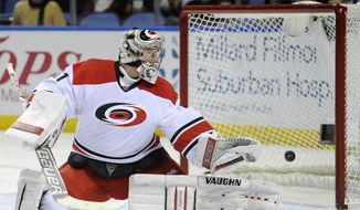 Carolina Hurricanes goaltender Anton Khudobin, of Russia, looks back after he is beaten for a goal by Buffalo Sabres'  Cody Hodgson during the first period of an NHL hockey game in Buffalo, N.Y., Thursday, Jan. 23, 2014. (AP Photo/Gary Wiepert)