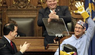 Wisconsin Gov. Scott Walker applauds as Chris Barber of Two Rivers, Wis.,  a welder at Ariens Company, leaves the podium during Walker's State of the State address at the state Capitol in Madison, Wis., Wednesday, Jan. 22, 2014. (AP Photo/Wisconsin State Journal, M.P. King)