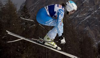 Julia Mancuso, of the United States, speeds down the course during an alpine ski,  women's World Cup super-g,  in Cortina D'Ampezzo, Italy,Thursday, Jan. 23, 2014. Mancuso placed 7th. (AP Photo/Domenico Stinellis)