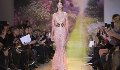 A model wears a creation by Lebanese fashion designer Zuhair Murad as part of his Spring-Summer 2014 Haute Couture fashion collection presentation, in Paris, Tuesday, Jan. 23, 2014 (AP Photo/Jacques Brinon)