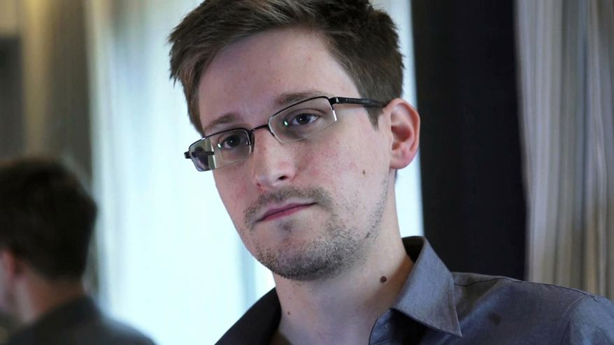 This photo provided by The Guardian Newspaper in London shows Edward Snowden, who worked as a contract employee at the National Security Agency, on Sunday, June 9, 2013, in Hong Kong. USIS, the company that handled a background check on National Security Agency leaker Edward Snowden allegedly defrauded the government by submitting at least 665,000 investigations that had not been properly completed, and then tried to cover it up when the government suspected what was going on. (AP Photo/The Guardian)