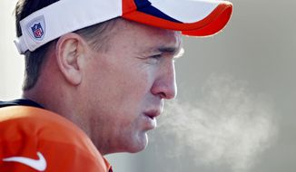 The breath of Denver Broncos quarterback Peyton Manning exhales as he talks to the media after NFL football practice at the team's training facility in Englewood, Colo., on Thursday, Jan. 23, 2014. The Broncos are scheduled to play the Seattle Seahawks in Super Bowl XLVIII on Feb. 2. (AP Photo/Ed Andrieski)
