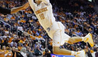 Tennessee guard Meighan Simmons (10) is fouled as she shoots in the first half of an NCAA college basketball game against Florida Thursday, Jan. 23, 2014, in Knoxville, Tenn. (AP Photo/Wade Payne)