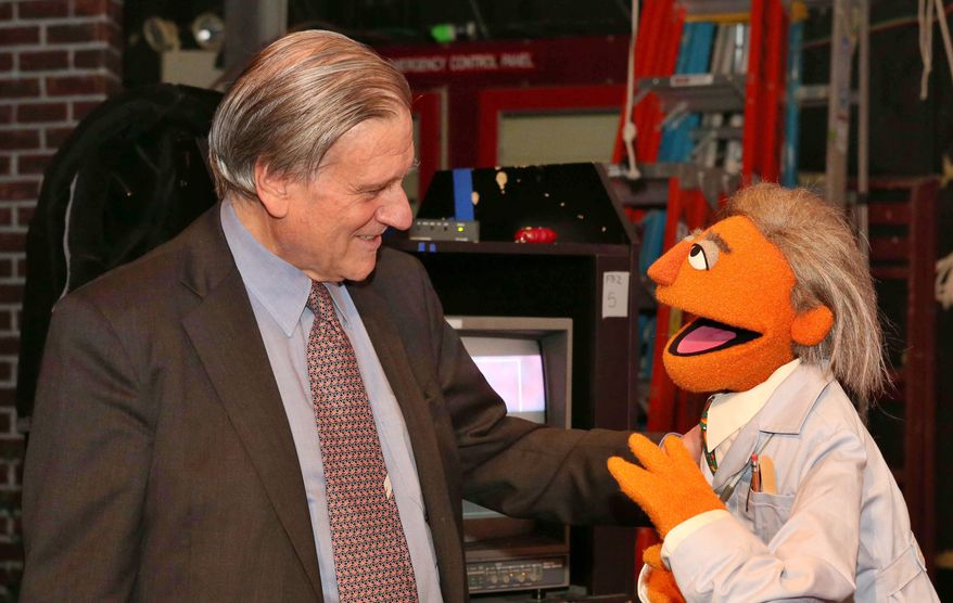 "In this May 1, 2012 photo provided by Sesame Workshop, Dr. Valentin Fuster, a cardiologist at New York's Mount Sinai Hospital, stands with a Muppet character based on him, ""Dr. Ruster,"" in the Sesame Street studios in the Queens borough of New York. Fuster, who teamed up with Sesame Street on a project to improve kids' health, has shown progress in a study in Colombia. In 2014, the project is planned to launch in New York in what sponsors hope will be a first step to fight childhood obesity nationwide. (AP Photo/Sesame Workshop, Richard Termine)"