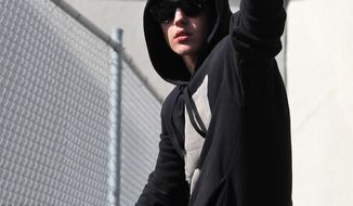 Singer Justin Bieber waves from atop an SUV as he leaves the Turner Guilford Knight Correctional Center, Thursday, Jan. 23, 2014, in Miami. Bieber was released from jail Thursday following his arrest on charges of driving under the influence, driving with an expired license and resisting arrest. Police say they stopped the 19-year-old pop star while he was drag-racing down a Miami Beach street before dawn. (AP Photo/El Nuevo Herald, Hector Gabino) FLORIDA KEYS OUT, MAGS OUT, NO SALES. DIARIO LAS AMERICAS OUT